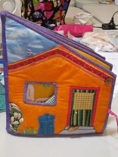 Doll House Book DIY - book folds flat for storage and opens up to make lots of different rooms in doll house - brilliant When I make this I will have a the fridge oven cabinets bath tub open up so you can play with the dolls Sewing Toys, Sewing Crafts, Sewing Projects, Felt Books, Quiet Books, Sewing For Kids, Diy For Kids, Fabric Toys, Fabric Houses