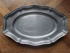 Vintage French medium Pewter Etain dish tray charger platter plate serving table display old aged used circa 1950-60's Purchase in store here http://www.europeanvintageemporium.com/product/vintage-french-medium-pewter-etain-dish-tray-charger-platter-plate-serving-table-display-old-aged-used-circa-1950-60s-2/