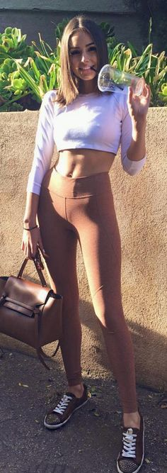 Olivia Culpo: Purse – Celine  Shirt – American Apparel  Pants – Outdoor Voices  Shoes – The Frye Company
