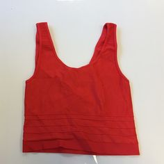 Bebe red coral crop top size small Bebe red coralish crop top size small pre-loved and used once for a few hours ..great condition bebe Tops Crop Tops