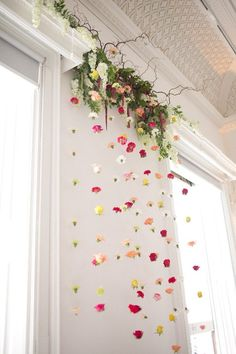 Hanging flower backdrop - wedding ceremony flowers