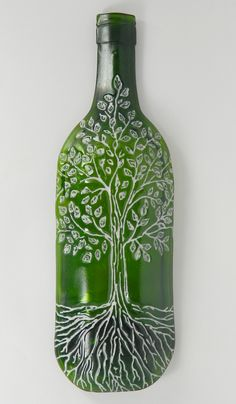 Tree Of Life Bottle Dish - Green with paint - £14.  The image is imprinted into the bottom of a wine bottle dish. The image can then be painted using a paint which is permenently fired into the glass. Can be made with or without a metal hook in the top.  www.glassbygenea.co.uk #fusedglass