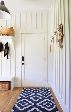 Love the shelf and hooks over bench