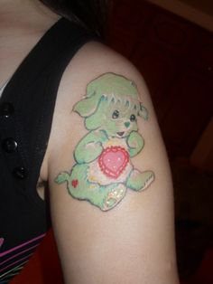 This is my third tattoo I got so far! I love the Care Bears and the Care Bears Cousins, but my favorite of all is Gentle Heart Lamb, because she's is shy and gentle and sometimes she cries when she's alone and can't do anything by herself, like me sometimes, that's why I got her! The tattoo artist did a good work on some details, on the head, on the tummy symbol. It is still freshed.  Done at Lucifer's Tattoo Studio, Lisbon Portugal!
