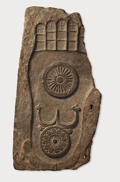 Footprint of the Buddha. Sikri, Khyber Pakhtunkhwa province 2nd–3rd century CE. Schist H. 37 x W. 19 11/16 x D. 1 3/4 in. (94 x 50 x 4.5 cm). Lahore Museum, G-124  The footprint of the Buddha (buddhapada) was one of the earliest symbols used in Buddhist art. It stands for his former physical presence and is an object of profound veneration. The swastikas at the tips of the toes and the omega symbol on the heel are auspicious symbols. The central wheel represents the Buddhist doctrine.