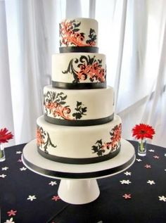 white, black and red wedding cake w/ filigree stencil and piping