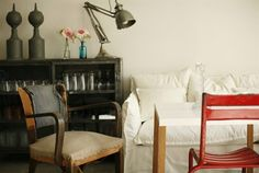 nice mix....chairs, linen, lamp, table. metal cabinet  B L O O D A N D C H A M P A G N E . C O M: