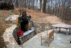 fireplace built into hill in backyard