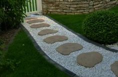 Simple bordered path with stepping stones.   White stones don't stay pretty for long in the yard, so use brown or gray stones instead for the filler.