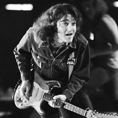 "[57] ""It seems a waste to me to work and work for years,"" Rory Gallagher told Rolling Stone in 1972, ""and just turn into some sort of personality."" Instead, the Irish guitarist, then only 23, became legendary for his nonstop-touring ethic and fiery craft. Playing a weathered Strat, often wearing a flannel shirt, Gallagher electrified Chicago and Delta styles with scalding slide work and hard-boiled songwriting"