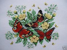 This is a new, completed cross-stitch Beautiful Butterflies. This stunning cross-stitch will make a great addition to your cross-stitch collection or will be a nice gift to someone special. The design was stitched on white Aida fabric with DMC floss, measures 7.5 wide by 6.75 high, fabric