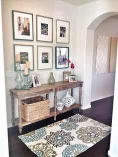 Gallery wall, wood console, glass accents, console styling, contemporary rug, coastal style