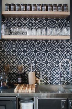 Patterend Tile + Open shelving at Distilled beauty bar in Calgary. See more n the west elm blog