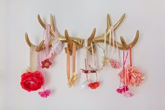 Cute idea! Antler headband holder for baby's room. Feminine Nursery in Coral and Gold