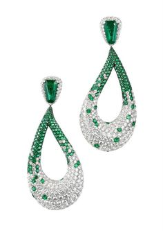 De Grisogono Earrings in white gold set with: 2 emeralds tappers: 5.18 cts 451 emeralds: 6.10 cts 692 white diamonds: 22.66 cts