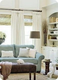 Look at woven blinds with long curtains (which actually have a large stripe of patterned fabric at the bottom), sisal rug.