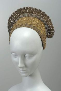 Gold Brocade with gold thread, spangles and beads.  Trimmed with gold lace, some wired to stand up from crown of cap.  No known country of origin or date.  @ MFA Boston