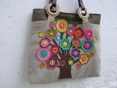 Crochet flowers on a handbag.