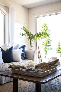 Advantage Property Styling, Coastal, Luxurious, Palms, Linen Sofa, Cushions, Navy, White, Coffee Table, Coral, Rattan, Interior Decoration