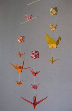 Hey, I found this really awesome Etsy listing at https://www.etsy.com/listing/194884892/mix-sized-origami-mobile-10-cranes-and-3