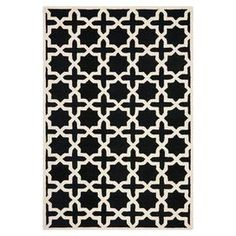 Hand-tufted wool rug with Moroccan trellis motif.  Product: RugConstruction Material: WoolColor: Black and ivoryFeatures:  Made in IndiaHand-tufted  Note: Please be aware that actual colors may vary from those shown on your screen. Accent rugs may also not show the entire pattern that the corresponding area rugs have.Cleaning and Care: Professional cleaning recommended