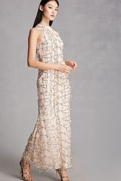 A semi-sheer mesh knit maxi dress featuring a sequin design throughout, high neckline, a sleeveless cut, and a concealed back zipper. This is an independent brand and not a Forever 21 branded item.
