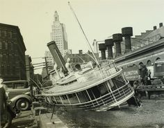 Damaged ferry boat sitting in shallow water in Providence Rhode Island. Rhode Island History, Ferry Boat, Boston Public Library, Historical Society, Natural Disasters, Long Island, New England, Places To Visit, City
