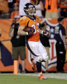 32282f6cc Denver Broncos wide receiver Wes Welker scores a touchdown against the Baltimore  Ravens during the second half of an NFL football game