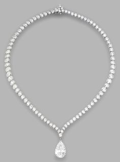 A HIGHLY IMPORTANT PLATINUM AND DIAMOND PENDANT-NECKLACE, HARRY WINSTON. The pear-shaped diamond weighing 10.02 carats, completed by a necklace set with pear-shaped and round diamonds weighing a total of approximately 30.00 carats, length 16 inches, signed HW for Harry Winston, numbered 65522 and 64108.  With signed pouch.