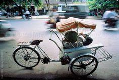 Rickshaw driver taking a break on busy Hanoi street. by Hugh Sitton - Stocksy United Take A Break, Us Images, Hanoi, Design Elements, Vietnam, The Unit, Stock Photos, Street, Elements Of Design