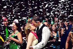 """Steph of Applehead Studio in Halifax says, """"As soon as I found out I was shooting a New Years wedding all I could think about was the midnight kiss…"""" Two groomsmen manned the confetti guns. We are so glad she nailed this with the perfect moment of confetti falling."""