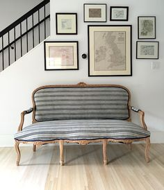 This vintage french settee's timeless silhouette is brought to life by an equally classic Swedish ticking fabric.