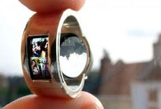 Projector wedding ring,  It has a mini lens and transparent slide with a tiny image of the couple that is 'projected' when you shine light through it.
