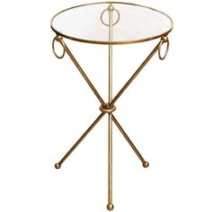 Brass ring drink table with glass top and tri-pod legs, c. 1950  USA  c. 1950  Brass ring drink table with glass top and tri-pod legs, c. 1950