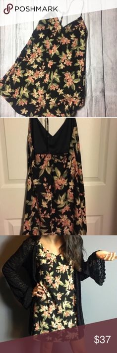 Chic floral print chiffon dress Black dress with flower prints. Orange and yellow flower prints. Has under lining around the chest area only. It has a a halter spaghetti strap design to it. Dorimas Closet Dresses