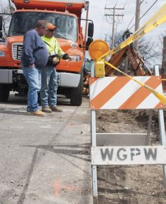 Webster Groves Public Works ripped up the sidewalk to add a dip in the concrete. After construction is complete, they will add the lines for...