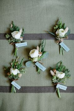 Rustic modern boutonnieres, ranunculus and evergreens. Fleurie | Flower Studio. Photography: Abby Grace Photography