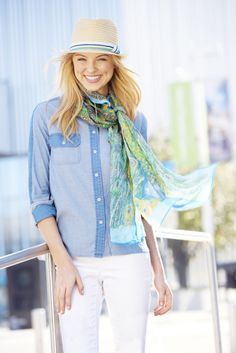 Liven up your look with a stylish straw floppy hat featuring crisscrossing bands of color.