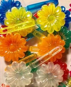 Primary Color Flower Barrettes with Sheen Neon Flowers, Twist Braids, Hair Barrettes, Primary Colors, Braided Hairstyles, Spring Twists, Hair Trim, Braid Hair, Braided Hair