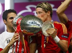 Spain's Fernando Torres kisses the trophy after defeating Italy to win the Euro 2012 final soccer match at the Olympic stadium in Kiev, July 1, 2012