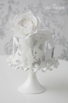 'DISTRESSED SILVER LEAF' Wedding Cake - White iced cake partly covered with edible silver leaf to give an antique effect.
