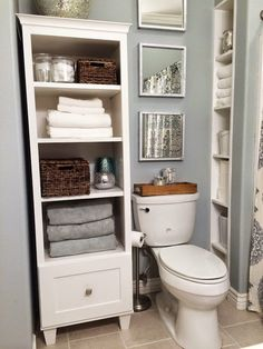 Innovative Bathroom Storage Ideas For Small Spaces Bathroom Storage Ideas diy over toilet cabinet for hair dryers apartment for towels Bathroom Towel Storage, Bathroom Shelves Over Toilet, White Bathroom Cabinets, Small Space Bathroom, Simple Bathroom, Small Spaces, Bathroom Mirrors, Bathroom Ideas, White Bathroom Storage Cabinet