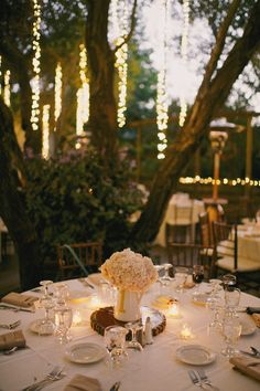 Cozy and intimate wedding decor. Looks like a secret garden with gorgeous lighting