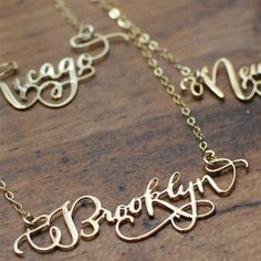 Caligraphy City Necklaces -