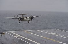 An E-2C Hawkeye assigned to the Screwtops of Aircraft Early Warning Squadron (VAW) 123 prepares to land on the flight deck of the aircraft carrier Dwight D. Eisenhower (CVN 69).