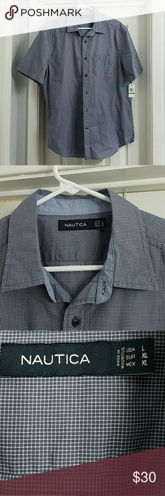 NAUTICA men's classic fit casual button down Bought this as a Christmas present for my husband and it doesn't fit.  We never returned it so it's your gain.  Classic casual button down designed for warm weather and comfort.  Modern plaid pattern in light blue. It's brand new, never been worn. Non - smoking, pet friendly house. Nautica Shirts Casual Button Down Shirts