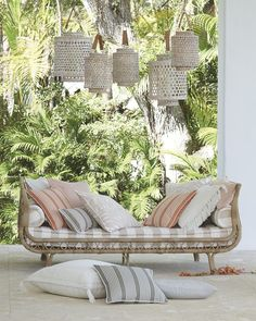 Made of hand-wrapped resin, this airy daybed is a dreamy place for an afternoon nap on your porch or patio. Complement its chic look with throw pillow styling.
