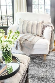 How to quickly change the look of your IKEA upholstered furniture using slipcovers to make them look updated and high-end. #ikeasofa #slipcover