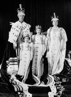 King George VI, Queen Elizabeth (the Queen Mother), Princess Margaret Rose, in front of her father, Princess Elizabeth (future Queen Elizabeth II) next to her mother.