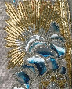 Detail embroidery, 3-piece court suit, wedding suit of Gustav III. of Sweden, Sweden, 1766. Silver silk lamé, embroidered with blue foil, gold threads and sequins. The design consists of clouds and blazing suns with flower seedlings.